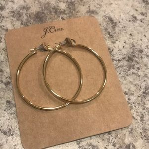 Jcrew gold hoops. Never worn. Only tried on.